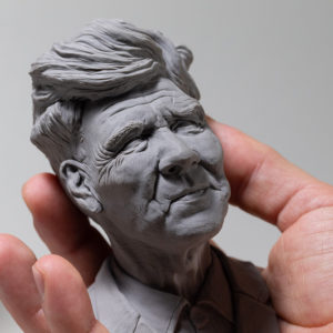 "photo of the sculpture ""David Lynch"" the original made by the artist Teddy Ros in polymer clay"
