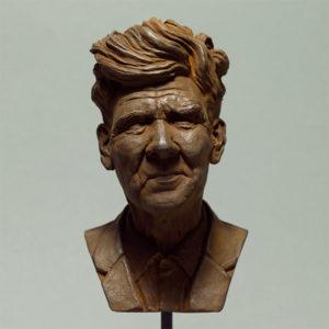"""photo de la sculpture """"David Lynch"""" patine oxydation forte réaliser par l'artiste Teddy Ros en patte polymère"""