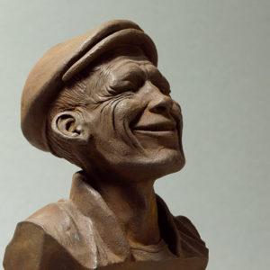 """photo de détails de la sculpture """"mr smile"""" 2018 tirage résine polyuréthane patine oxydation forte, réaliser par l'artiste Teddy Ros en plastiline"""