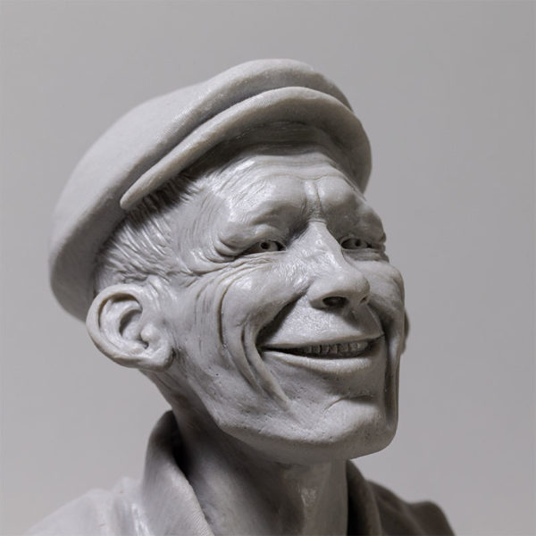 "detail photo of the sculpture ""mr smile"" 2018 polyurethane resin print without patina, made and sculpted by the artist Teddy Ros in plastiline"