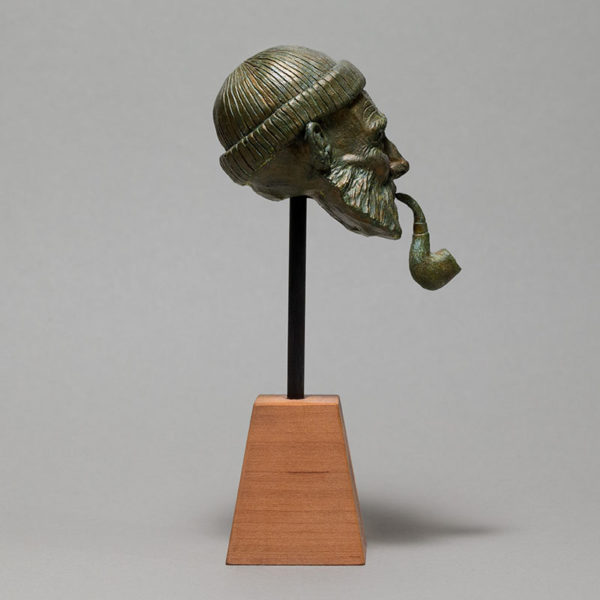 """photo de la sculpture """"le pêcheur"""" 2018 résine polyuréthane patine or vert, réaliser par l'artiste Teddy Ros en pâte polymère"""