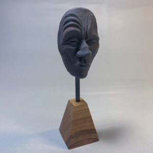 "photo of the sculpture ""mask 03"" 2019 the original polymer clay sculpture by Teddy Ros"