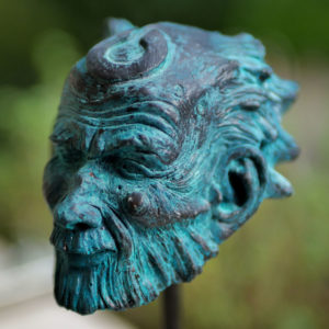 "photo of the sculpture ""Guardian"" 2020, plastiline realized by the artist Teddy Ros, resin print patina bronze blue base in drowned wood."